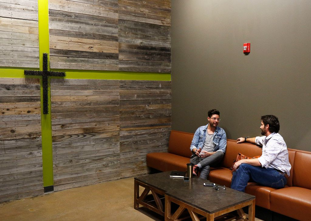 Kevin Tipps, left, and Jacob Robert relax at Hands + Rose Coffee, located inside of Upper Room Dallas on Tuesday, September 26, 2017. (David Woo/The Dallas Morning News)