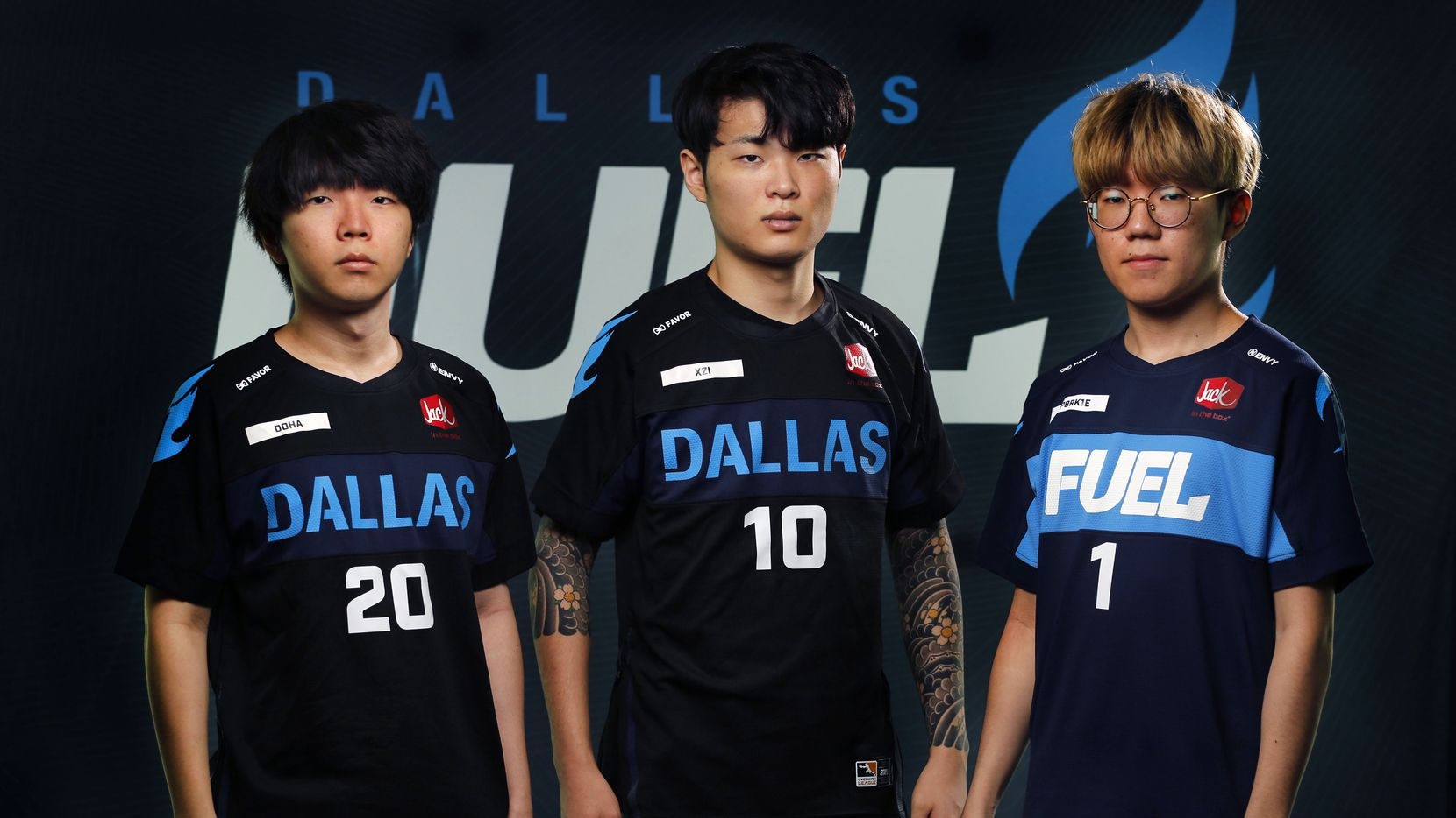 "Dallas Fuel players (from left) Kim ""DoHa"" Dong-Ha, Jung ""Xzi"" Ki-hyo and Kim ""Sp9rk1e"" Yeong-han pose for a photo at Envy Gaming headquarters in Dallas on Monday, March 29, 2021."