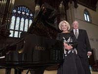 Dianne and Jack Adleta with the Fazioli grand piano they played an instrumental role in acquiring for Highland Park United Methodist Church in Dallas.