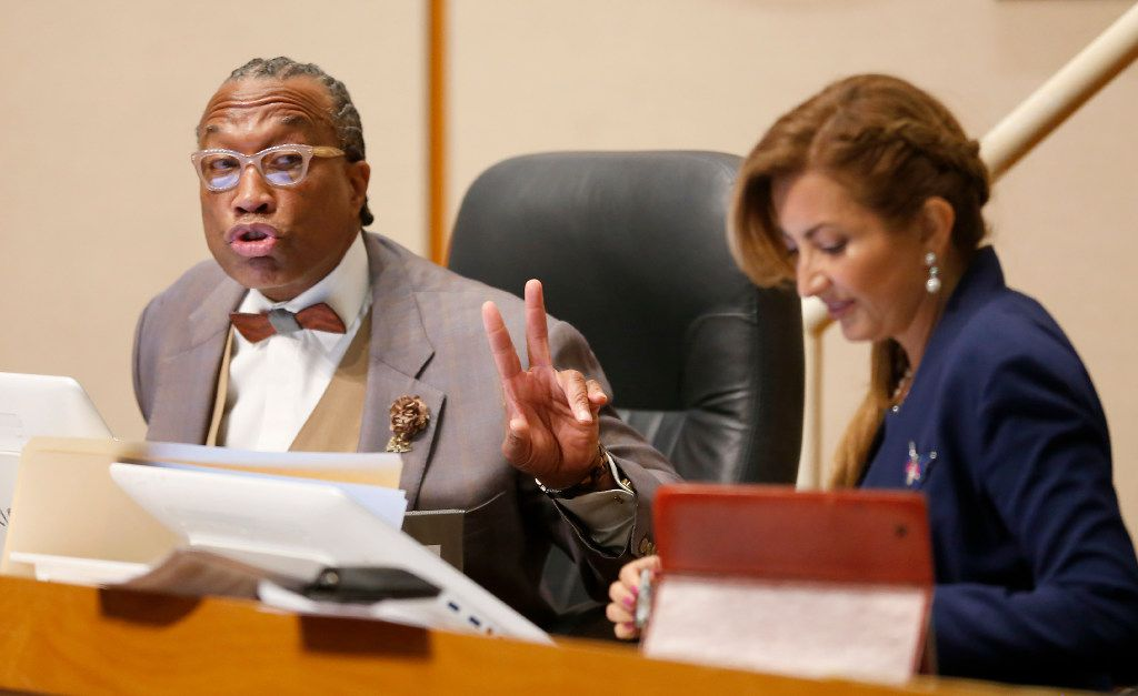 Dallas County Commissioner John Wiley Price speaks next to District 4 Commissioner Elba Garcia during a Commissioners Court meeting in May.