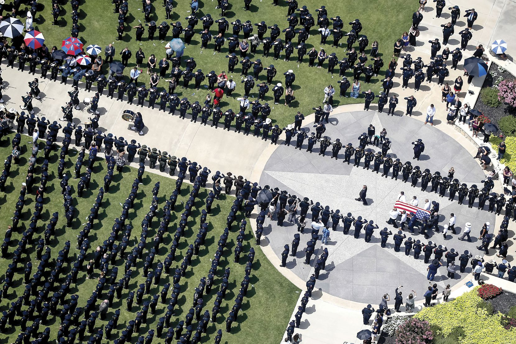 The casket of slain Dallas police officer Patrick Zamarripa was carried carried by pallbearers at Dallas-Fort Worth National Cemetery on July 16.