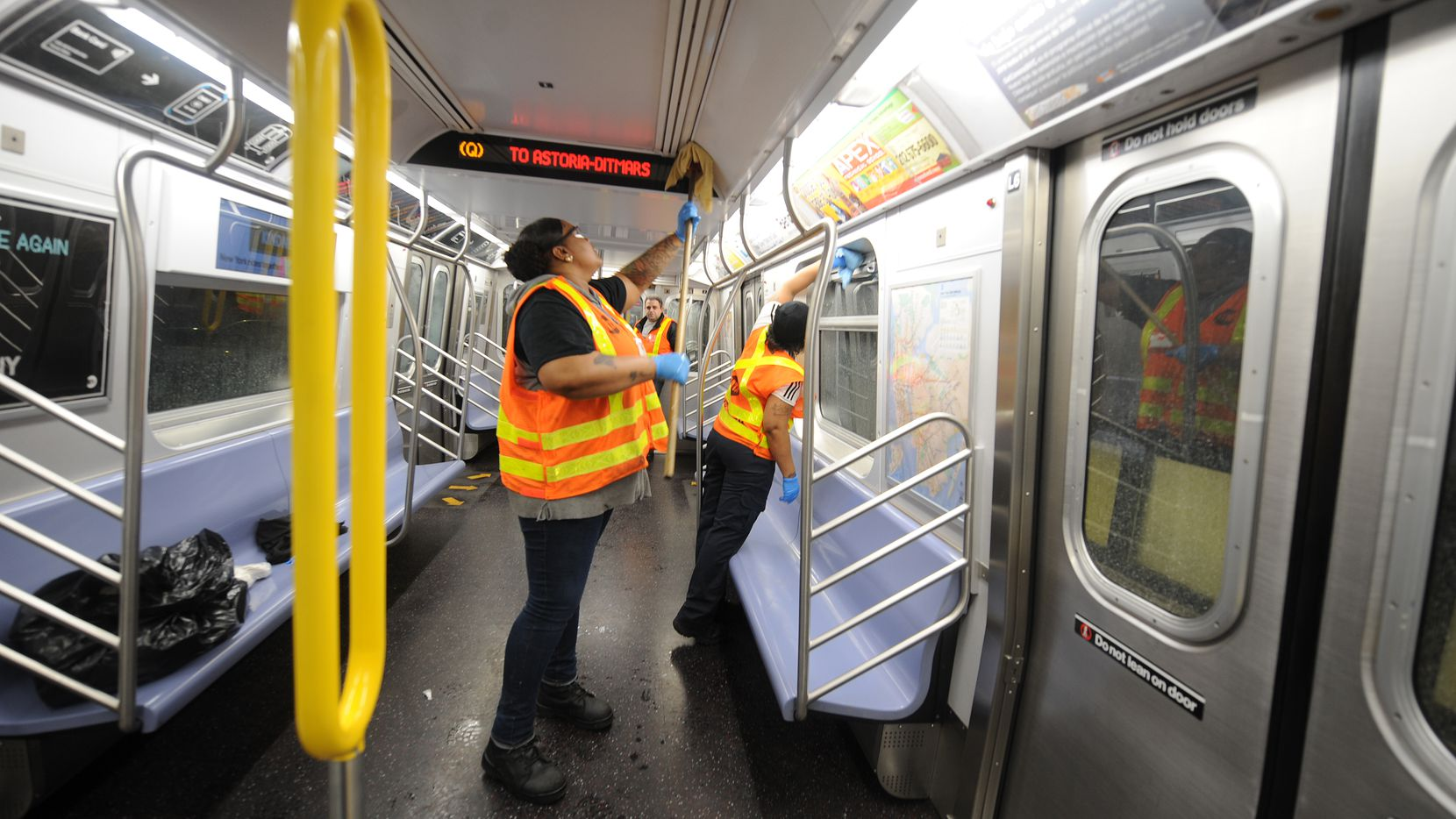 MTA personnel clean a subway car in Brooklyn, New York on Tuesday.