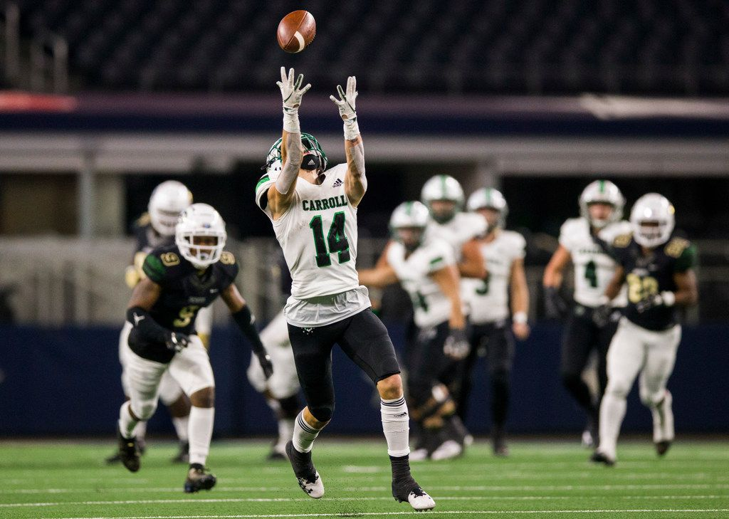 Southlake Carroll wide receiver Brady Boyd (14) reaches for a pass during the first quarter of a Class 6A Division I area-round high school football playoff game between Southlake Carroll and DeSoto on Friday, November 22, 2019 at AT&T Stadium in Arlington. The pass was incomplete. (Ashley Landis/The Dallas Morning News)