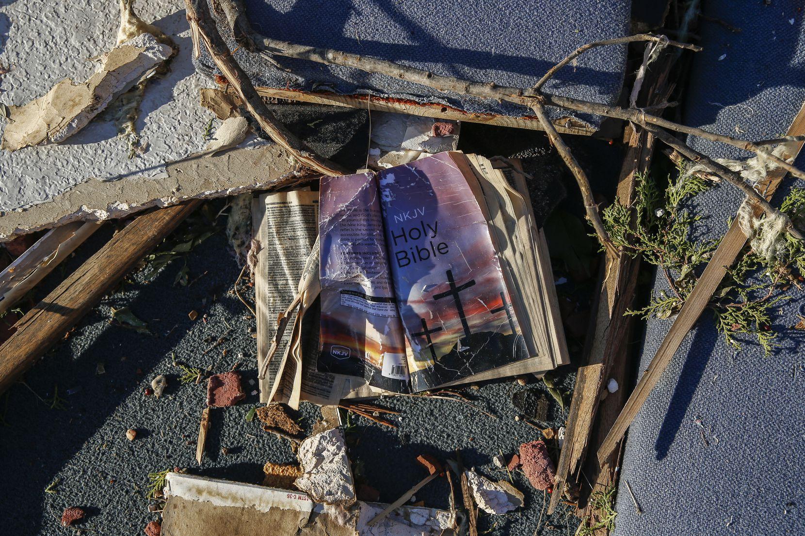 A bible is seen amongst the rubble at Primera Iglesia Bautista Mexicana church just off of Walnut Hill Lane in Dallas, on Monday, Oct. 21, 2019 after a tornado hit the night before.
