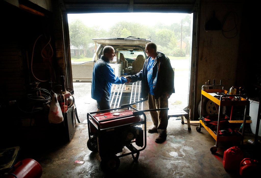 """With Hurricane Harvey swirling around outside Friday, Victoria coffee shop owner John Valdivia (left) was grateful that small engine repairman Ruben Rosas had called for him to pick up his newly repaired generator, the day Harvey made landfall. Rosas shook his hand and gave it to him on credit. """"If Victoria is still here. If not, we'll call it a freebie."""""""