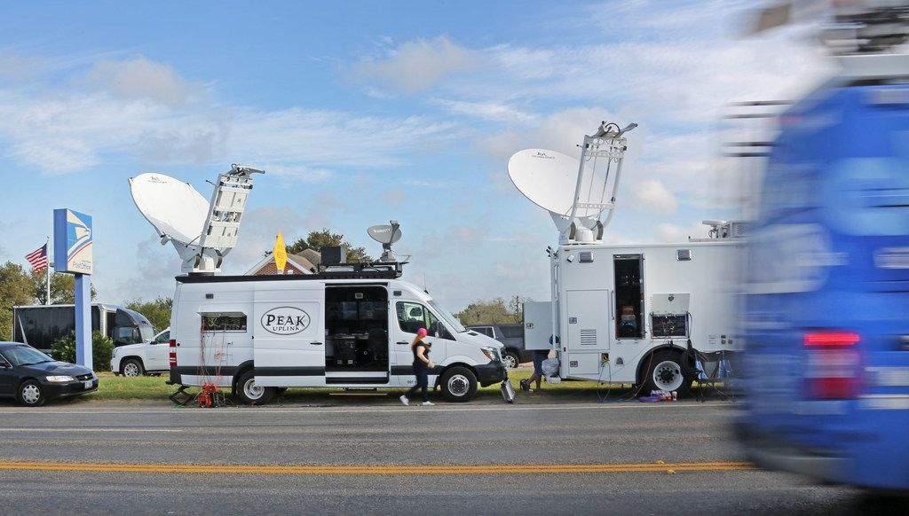 News crews gathered Monday near First Baptist Church of Sutherland Springs, where a gunman carried out a massacre Sunday.