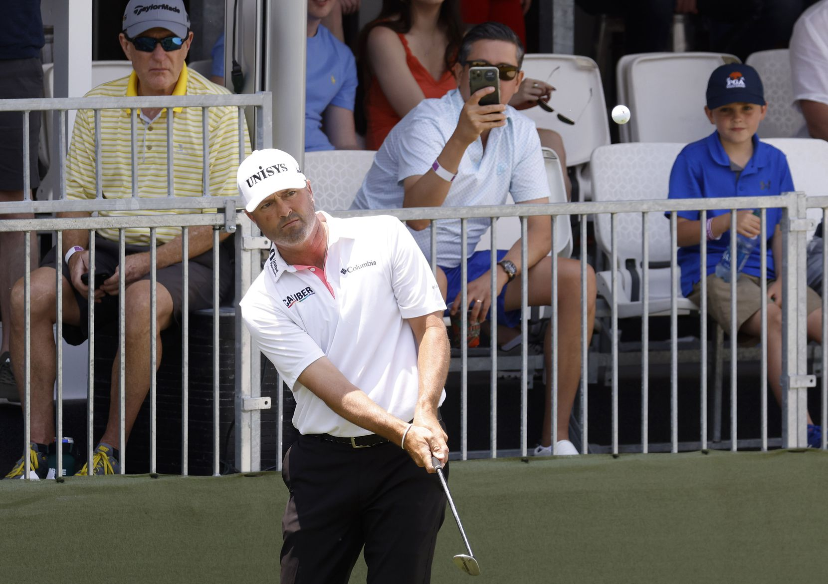 Ryan Palmer watches the ball get on the green on the 17th hole during round 3 of the AT&T Byron Nelson  at TPC Craig Ranch on Saturday, May 15, 2021 in McKinney, Texas. (Vernon Bryant/The Dallas Morning News)