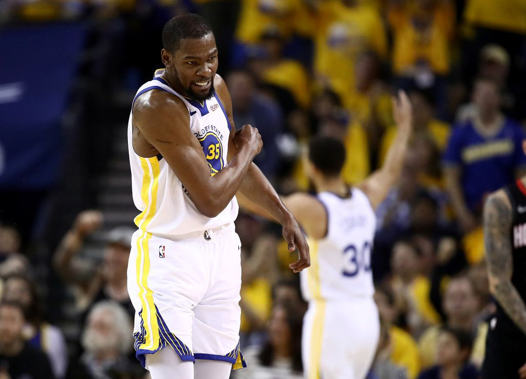 OAKLAND, CALIF. - MAY 08:   Kevin Durant (35) of the Golden State Warriors reacts after they scored a basket against the Houston Rockets during Game 5 of the Western Conference semifinals at ORACLE Arena on May 08, 2019, in Oakland, Calif.  (Photo by Ezra Shaw/Getty Images)