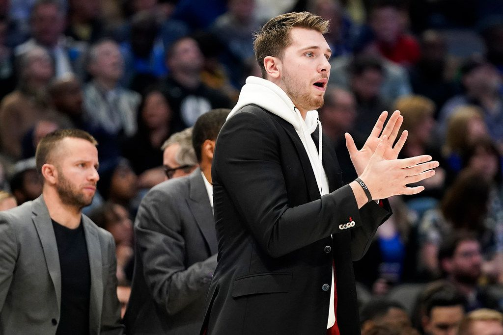 Injured Dallas Mavericks guard Luka Doncic encourages his teammates from the bench during the second half of an NBA basketball game at American Airlines Center on Wednesday, Feb. 5, 2020, in Dallas. (Smiley N. Pool/The Dallas Morning News)