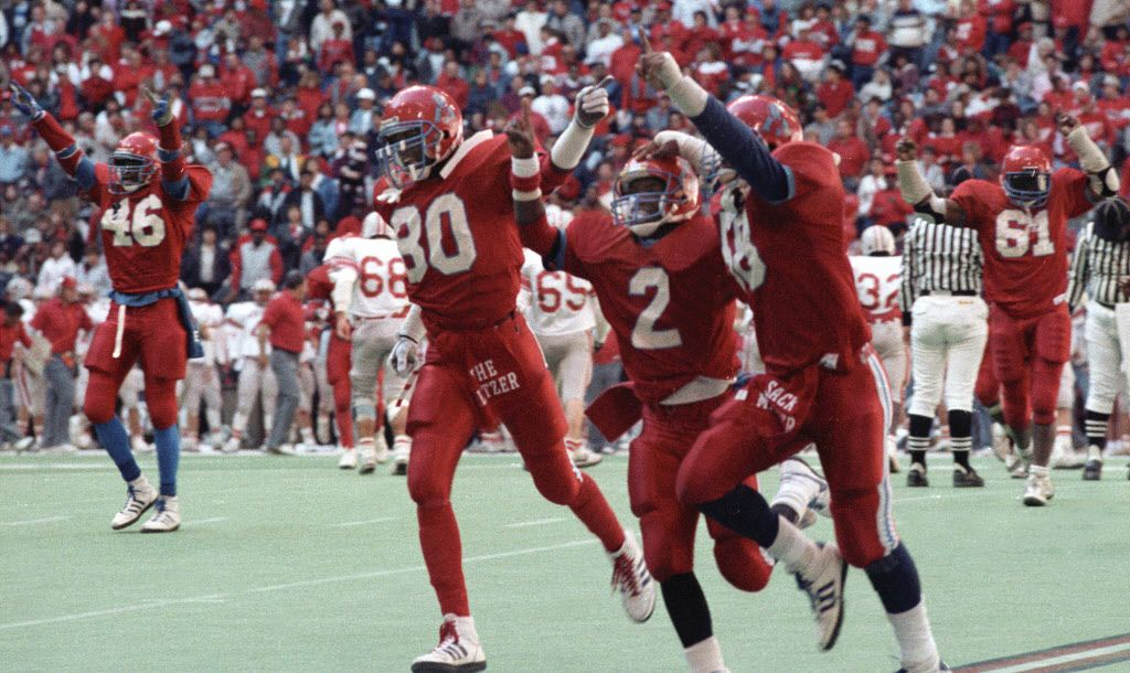 Derric Evans #80, Gary Edwards #2, Cedric Buckley  #58, of Carter high school, celebrate during the 5A state high school championship game at Texas Stadium against Converse Judson high school. Jessie Armstead #46 and Derrick Cherry #61 celebrates in the background.