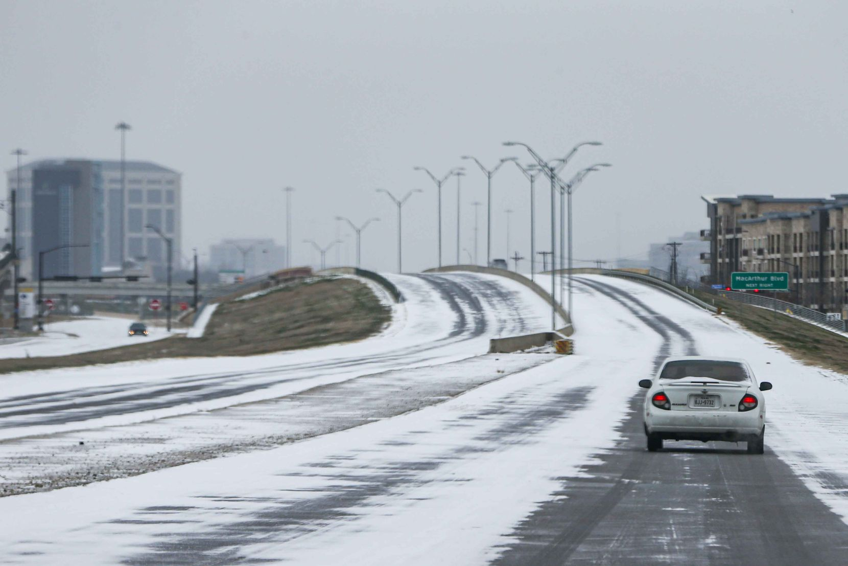 Light traffic on TX-348 Spur near MacArthur Blvd as winter flurries arrive in Irving on Sunday, February 14, 2021 ahead of major snowstorm.