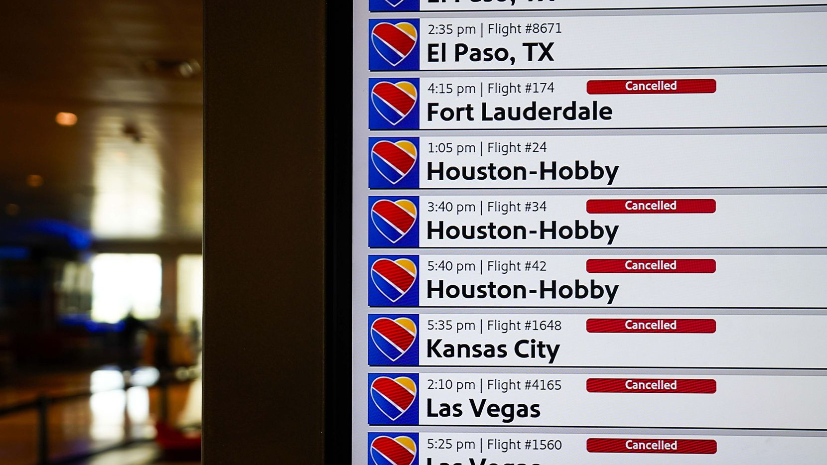 Flight status boards show cancelled Southwest Airlines flights at Dallas Love Field on Tuesday, April 14, 2020, in Dallas.  (Smiley N. Pool/The Dallas Morning News)