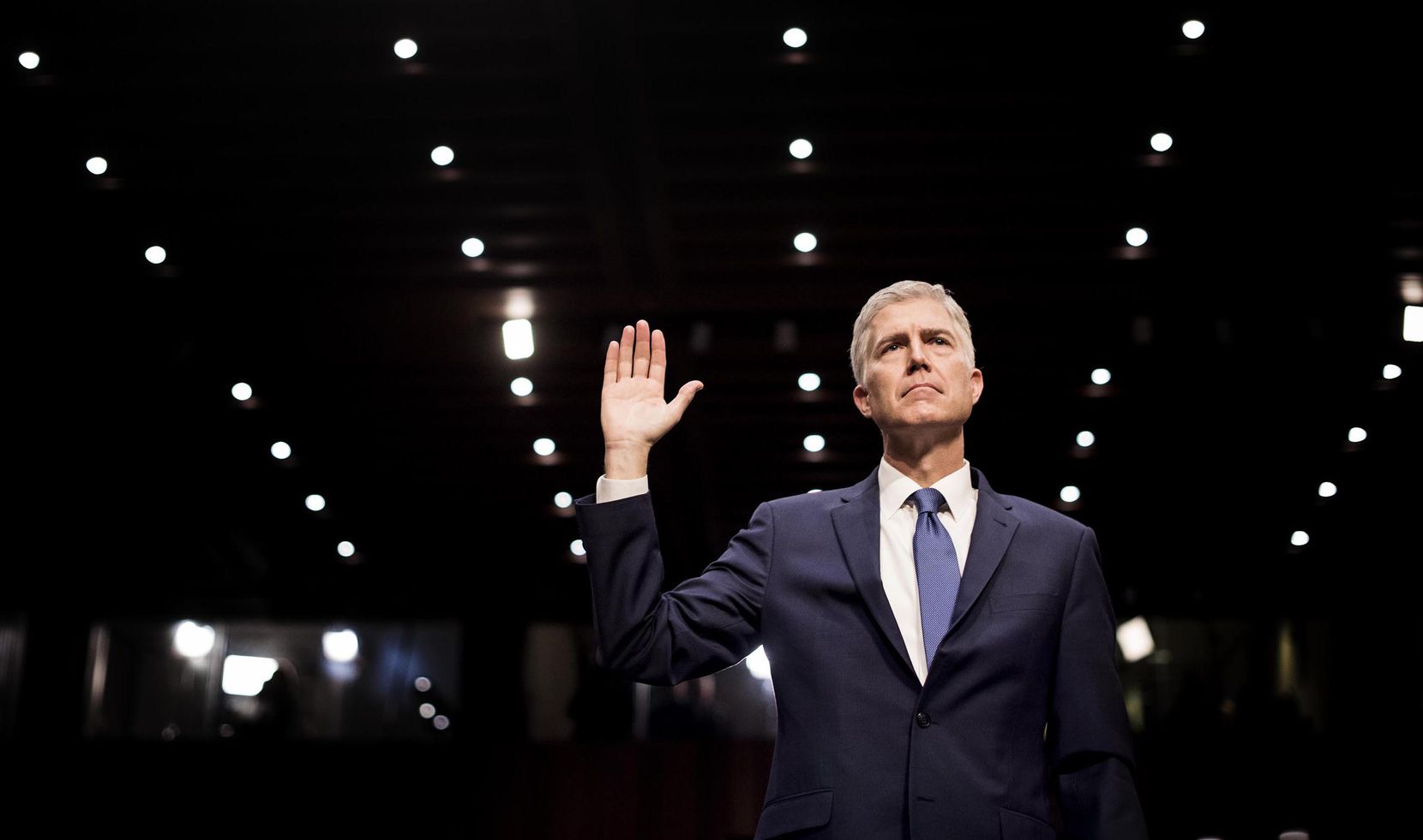 Neil Gorsuch, President Donald Trump's nominee for the Supreme Court, is sworn in Monday on Capitol Hill. In a 13-minute introductory address during his confirmation hearing, Gorsuch tried to reassure senators he was a mainstream jurist, who was in the majority in 99 percent of the 10 years of cases he decided on the appeals court.