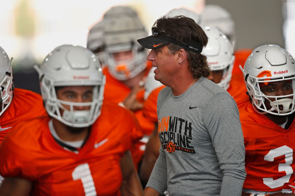 Oklahoma State head coach Mike Gundy during an NCAA college football practice in Stillwater Okla., Tuesday, Aug. 6, 2019.
