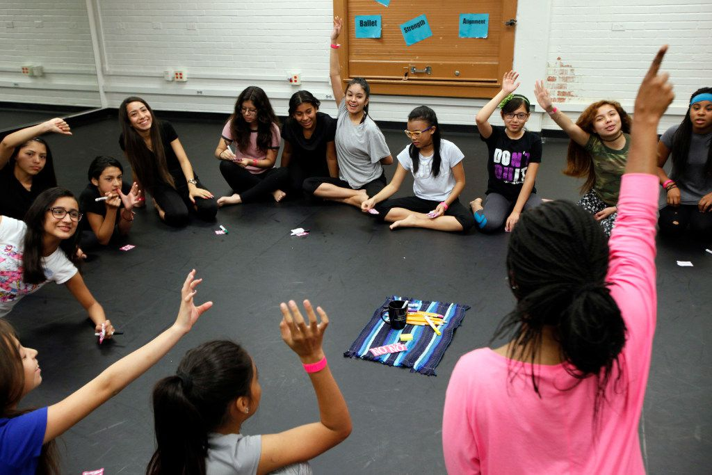 Dance teacher Alexis Brisby (in pink) asks her students to raise their hands during a vote to improve their class time during a Restorative Class session, also known to students as circling at Gaston Middle School in Dallas. (Ben Torres/Special Contributor)