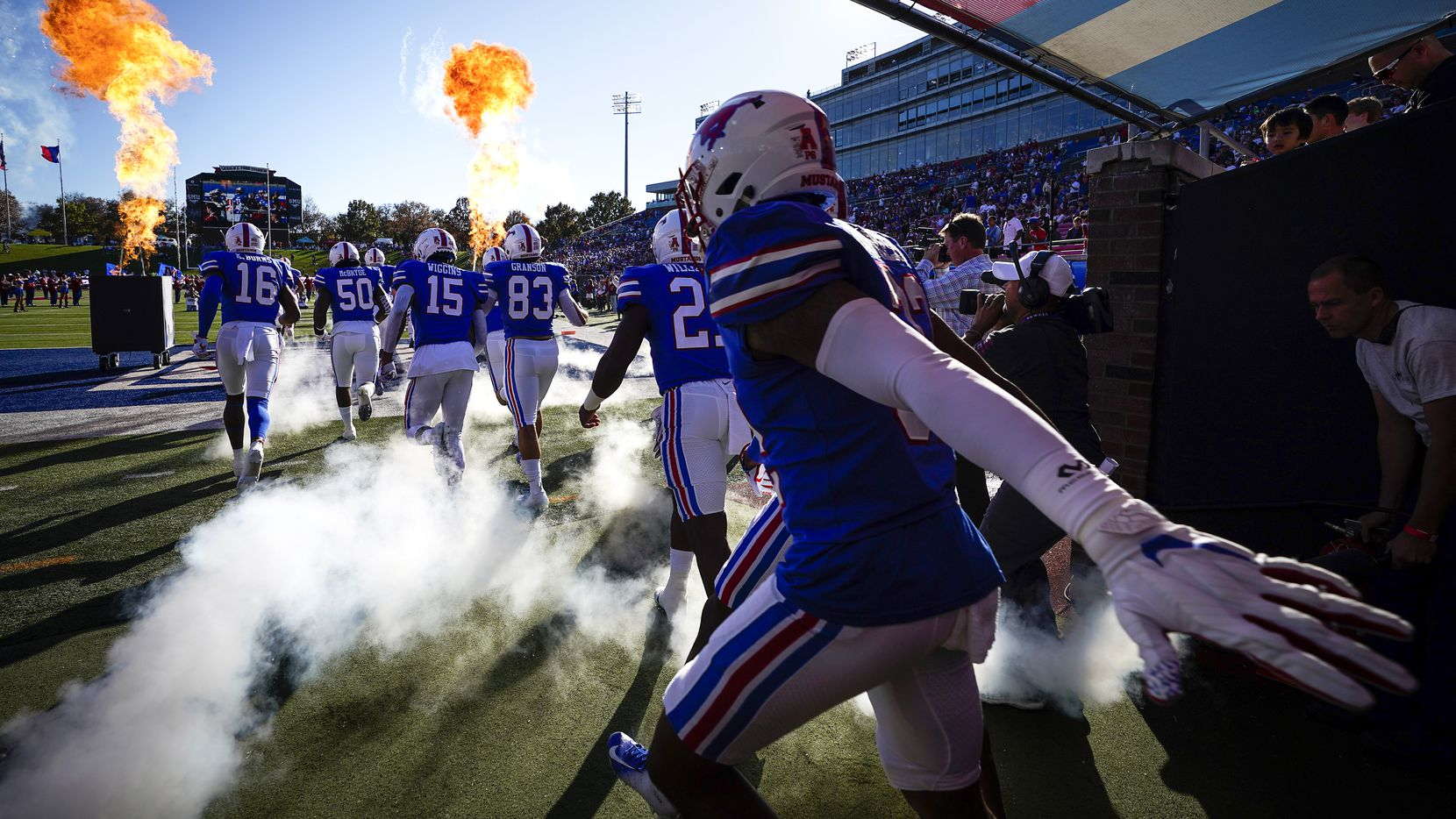SMU player take the field to face Tulane in an NCAA football game at Ford Stadium on Saturday, Nov. 30, 2019, in Dallas.