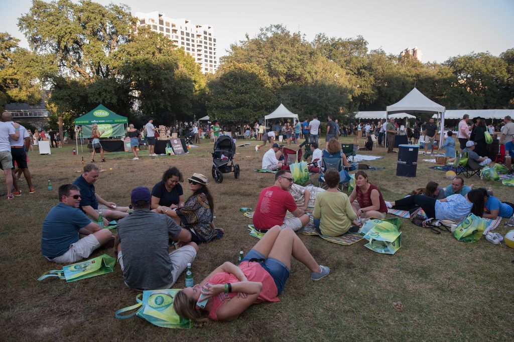 People relax on the lawn during Chefs for Farmers.