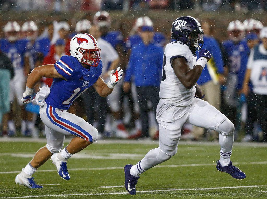 TCU running back Sewo Olonilua (33) runs past SMU linebacker Trevor Denbow (16) during the second quarter of an NCAA college football game Friday, Sept. 7, 2018, in Dallas. (AP Photo/Jim Cowsert)