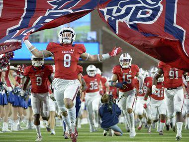 McKinney Boyd players run onto the field before a high school football game between Denton Braswell and McKinney Boyd, Thursday, Oct. 22, 2020, in McKinney, Texas.