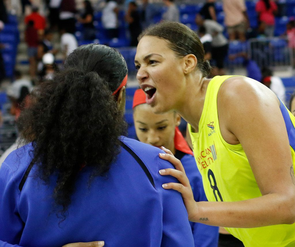 Dallas Wings center Liz Cambage (8) celebrates with teammates following their 77-67 victory over the Las Vegas Aces. Cambage scored a game-high 28 points to lead the Wings. The two teams played their WNBA game at UT-Arlington's College Park Center in Arlington on June 15, 2018. (Steve Hamm/ Special Contributor)