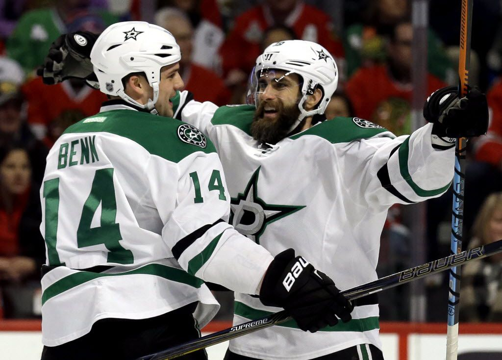 Dallas Stars right wing Patrick Eaves, right, celebrates with left wing Jamie Benn after scoring his first goal during the first period of an NHL hockey game against the Chicago Blackhawks on Thursday, Feb. 11, 2016, in Chicago. (AP Photo/Nam Y. Huh)