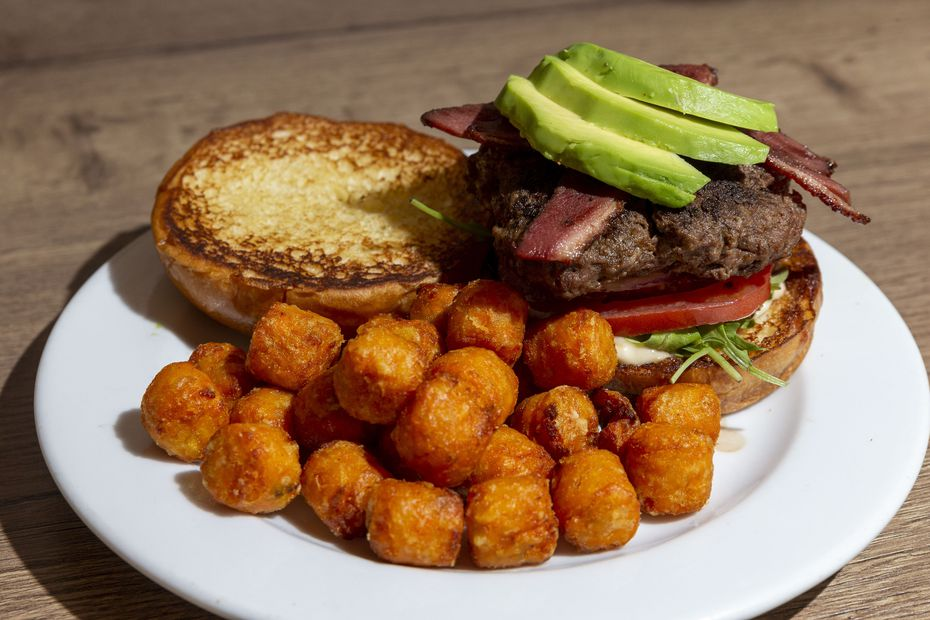 The ostrich burger with duck bacon and avocado at FireBird Fowl looks a whole lot like a regular beef burger.
