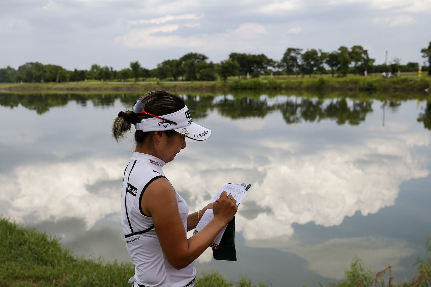 Professional golfer Jeongeun Lee6 signs her scorebook after recording a birdie on the 18th hole during day one of the LPGA VOA Classic on Thursday, July 1, 2021, in The Colony, Texas. (Elias Valverde II/The Dallas Morning News)