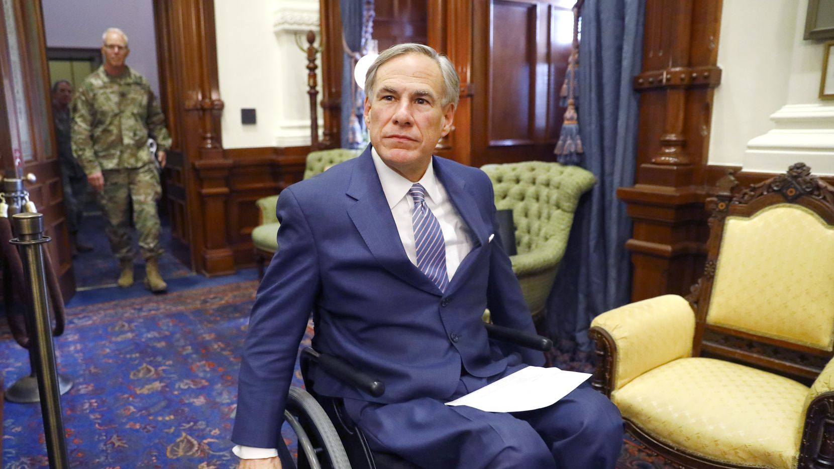 Gov. Greg Abbott, shown entering a March 29 coronavirus news briefing, recently was the butt of some jokes about his use of a wheelchair – and his alleged kowtowing to liberal Texas cities on mask requirements. Empower Texans staffers made the widely denounced remarks, and Abbott's pushing to defeat any GOP candidates in next month's runoffs connected to the group.