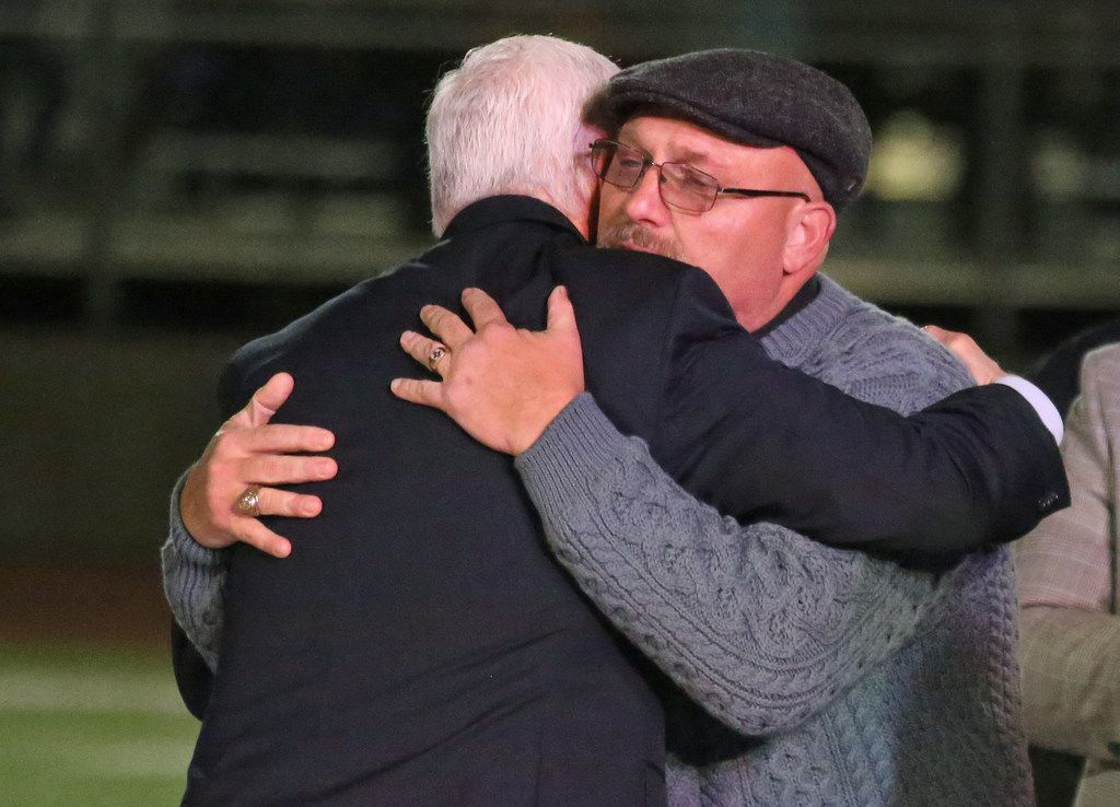 United States Vice President Mike Pence embraces First Baptist Church of  Sutherland Springs pastor Frank Pomeroy after the vice president's remarks at a memorial service at the Floresville High School football stadium in Floresville, Texas. Photographed on Wednesday, November 8, 2017. (Louis DeLuca/The Dallas Morning News)
