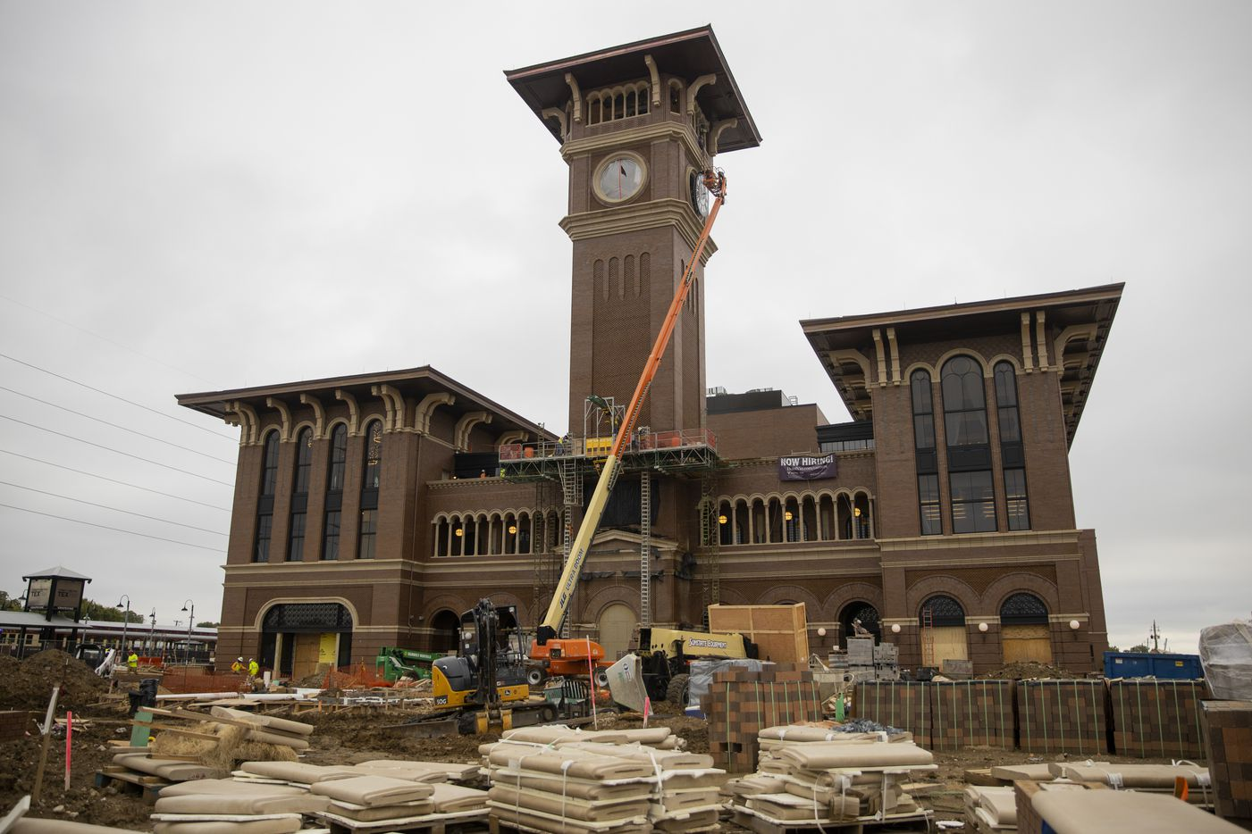 A crew from MEI Rigging & Crating works to install a 12-foot glass clock on the Grapevine Main Station's Observation Tower on Sept. 3, 2020 in Grapevine. The clocks designed by Electric Time Company were designed to be compatible with the Texas-Italianate style of the station. (Juan Figueroa/ The Dallas Morning News)