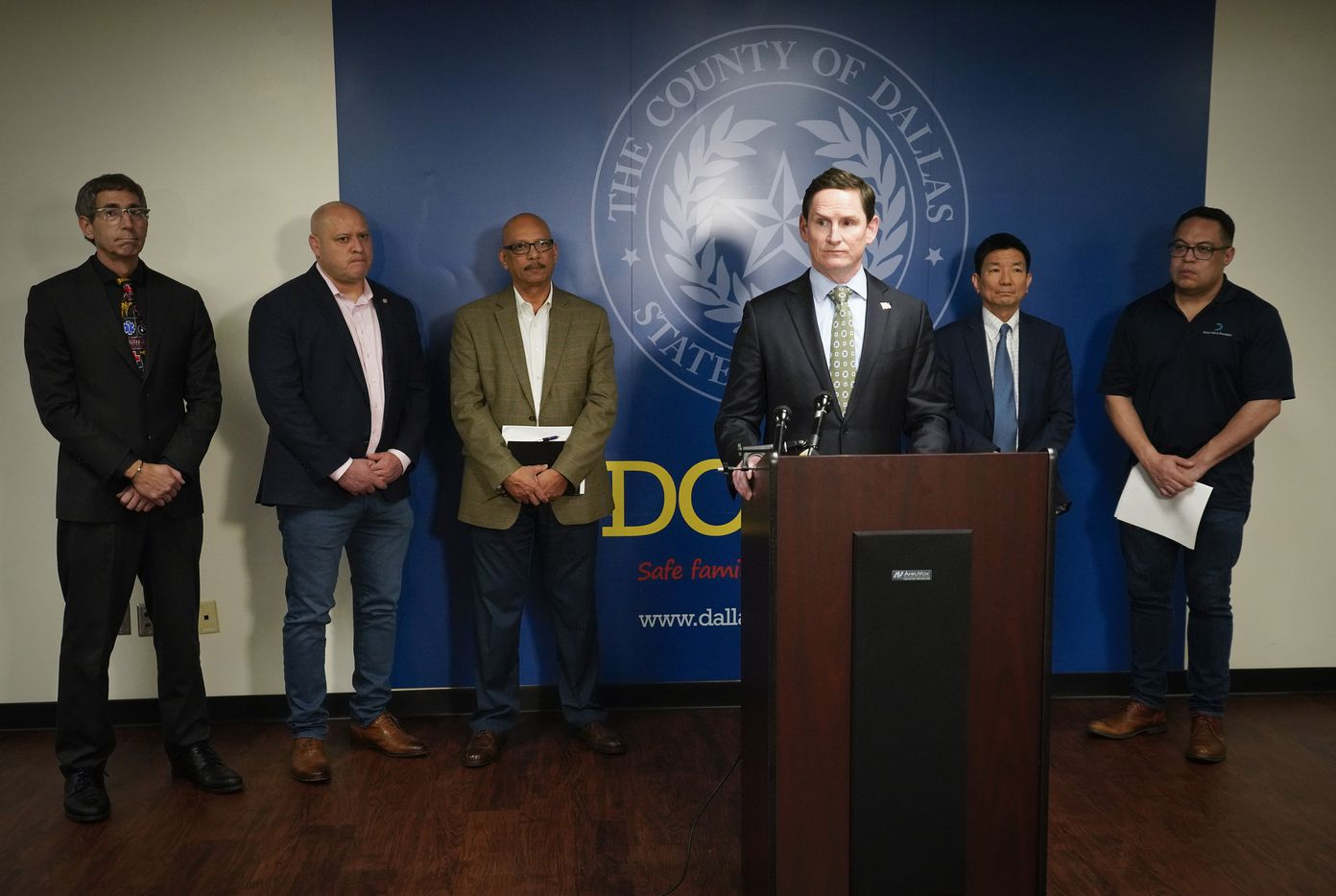 Dallas County Judge Clay Jenkins announces that a local state of disaster for public health emergency has been declared in the county, due to more cases of the new coronavirus, late Thursday, March 12. 2020, in Dallas. Behind him, from left, are Dr. Marshal Isaacs, Dallas Mayor Pro Tem Adam Medrano, Rocky Vaz, City of Dallas Director of Emergency Management, Dr. Philip Huang, Director of Dallas County Health and Human Services, and Dallas city council member Omar Narvaez.