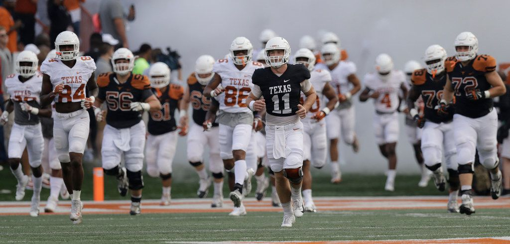 Texas quarterback Sam Ehlinger (11) leads the team on to the field during the team's Orange-White intrasquad spring college football game, Saturday, April 21, 2018, in Austin, Texas. (AP Photo/Eric Gay) ORG XMIT: otk15