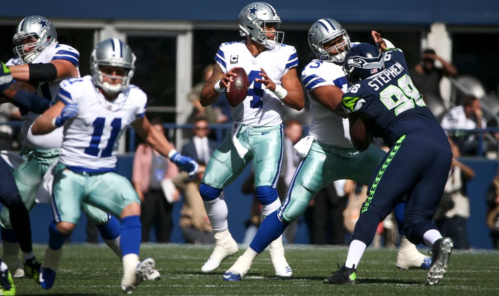 Dallas Cowboys quarterback Dak Prescott (4) looks to make a pass during the first quarter of an NFL game between the Dallas Cowboys and Seattle Seahawks on Sunday, September 23, 2018 at CenturyLink Field in Seattle. (Shaban Athuman/The Dallas Morning News)