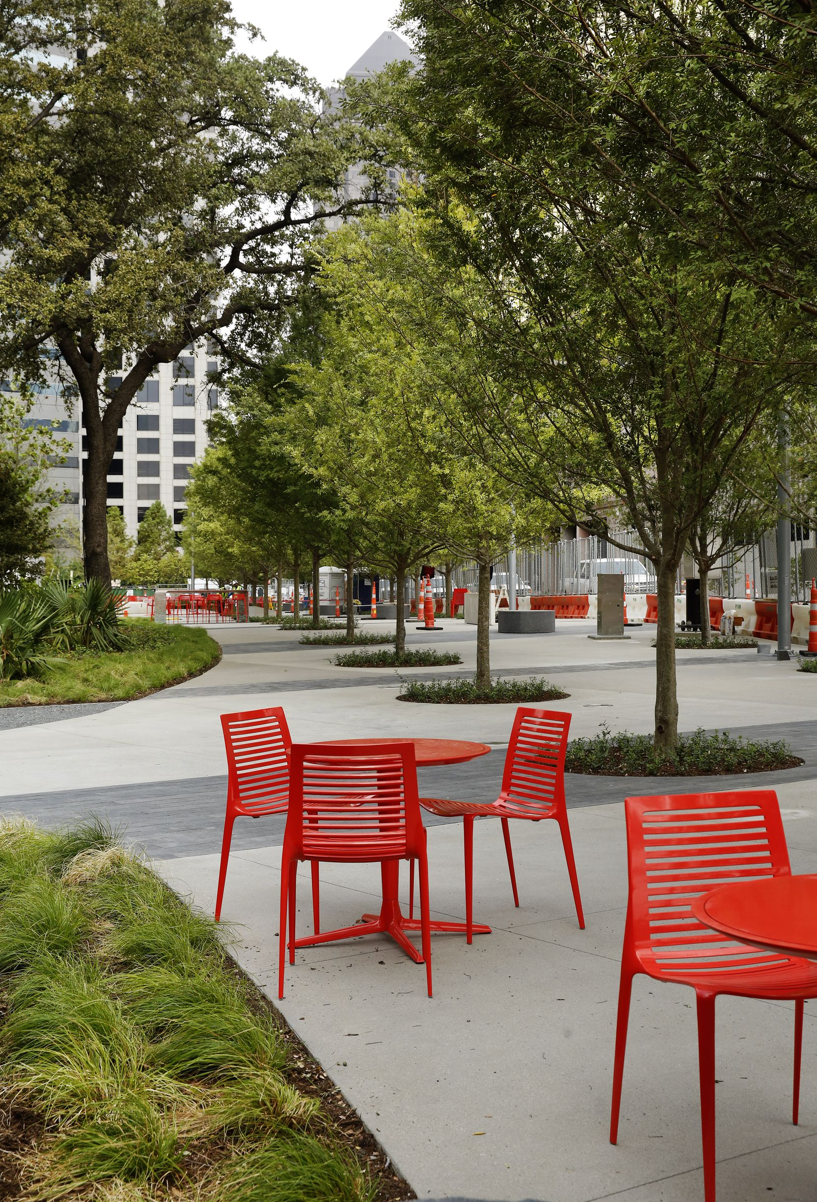 The Harwood Promenade, a tree-lined area along Harwood Street. Surrounded by high-rise buildings, Pacific Plaza, Dallas' newest downtown park, was designed by landscape architects SWA Group.