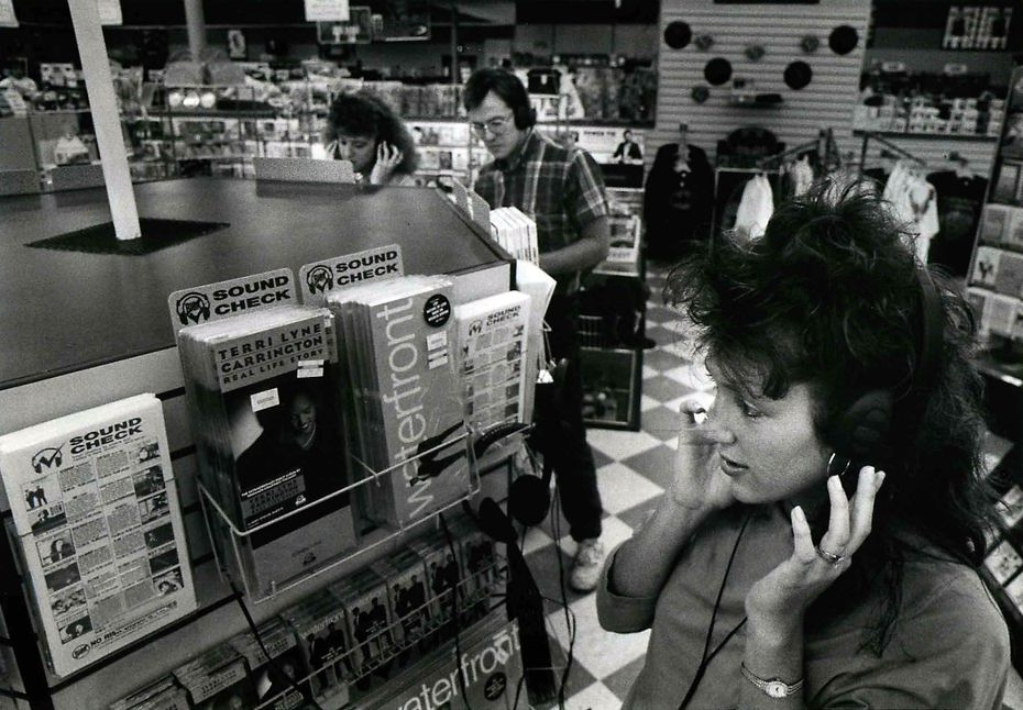 June 12, 1989: Terri McLeland checks out a new recording at Sound Warehouse on Greenville Avenue.