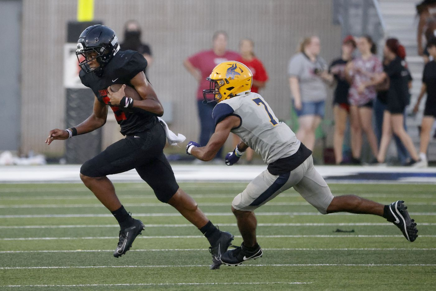 Trinity quarterback  Ollie Gordon (2) runs away from Arlington Lamar defender Lonnell Cunningham (7) during a first half of their high school football game in Bedford, Texas on Aug. 26, 2021. (Michael Ainsworth/Special Contributor)