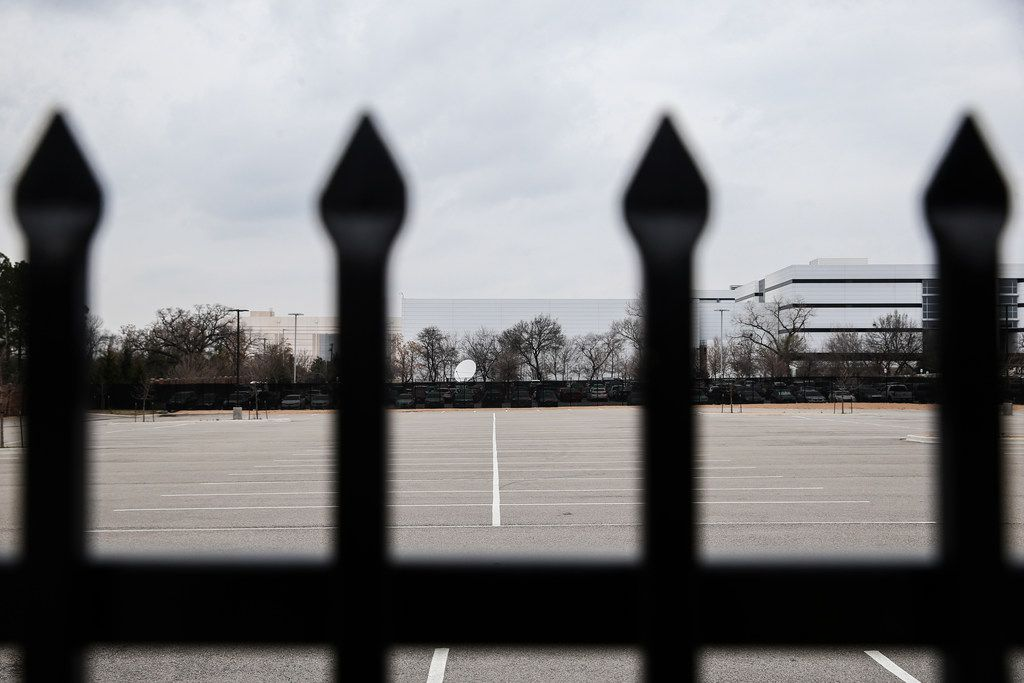 A locked fence and empty parking lot sat in the 2200 block of Burbank Street in Dallas on Feb. 6.