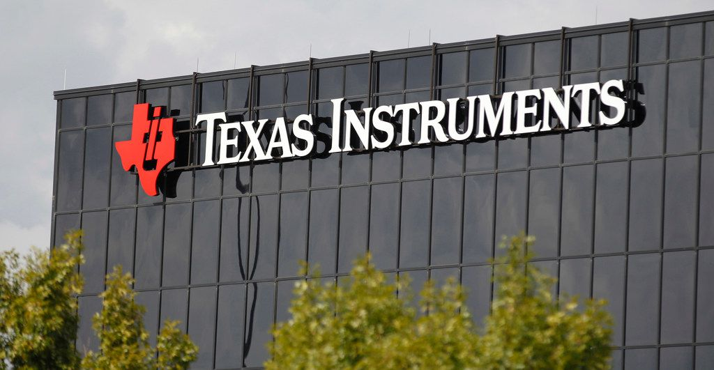 FILE - This Monday, Oct. 22, 2012, file photo shows corporate signage on the offices of Texas Instruments, in Richardson, Texas. On Tuesday, July 17, 2018, Texas Instruments dumped CEO Brian Crutcher for personal misconduct less than two months after he took over the job, ruining the chip maker's hopes for a smooth transition to new leadership. (AP Photo/LM Otero, File)