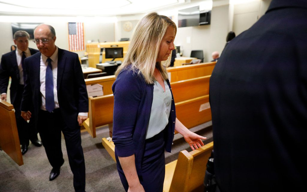 Fired Dallas police Officer Amber Guyger leaves the courtroom after she was found guilty of murder by a 12-person jury on Oct. 1, 2019.