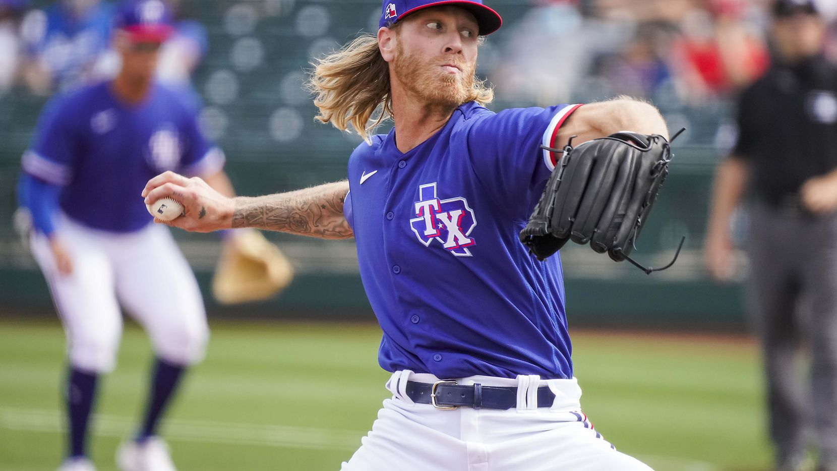 Texas Rangers pitcher Mike Foltynewicz delivers during the second inning of a spring training game against the Los Angeles Dodgers at Surprise Stadium on Sunday, March 7, 2021, in Surprise, Ariz.