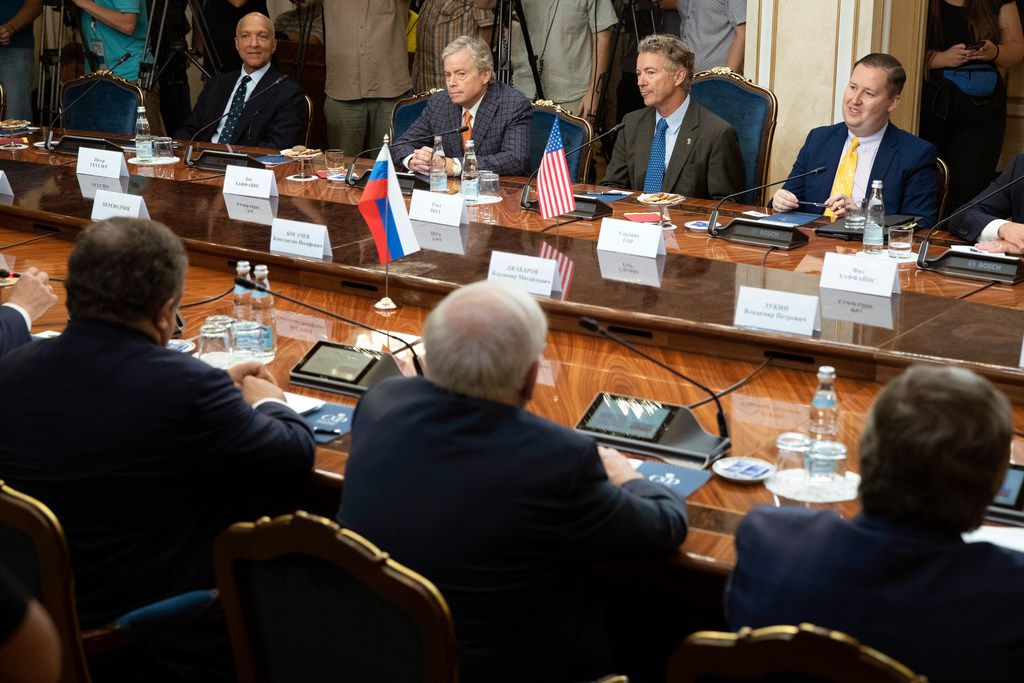 Top from left: a member of the Senate of the legislative Assembly of the state of Texas Peter Hettler, Texas Sen. Don Huffines, Sen. Rand Paul and his communications director Sergio Gor attend a meeting with Russian lawmakers in Moscow, Russia, Monday, Aug. 6, 2018. Paul said he has invited Russian lawmakers to visit the United States to help foster inter-parliamentary contacts.