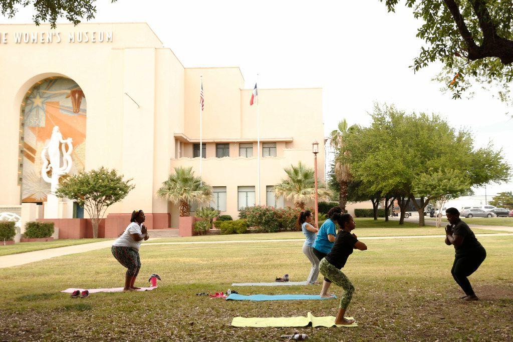 Instructor Ebony Smith leads a Yoga N Da Hood class at Fair Park in Dallas. (Vernon Bryant/The Dallas Morning News)