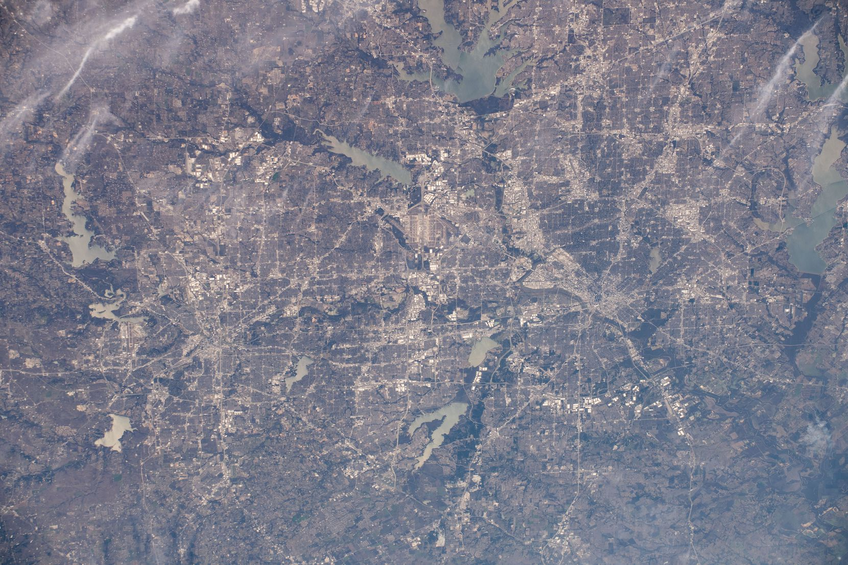 iss061e067843 (Dec. 6, 2019) --- The Dallas-Fort Worth, Texas metropolitan area is pictured along with such landmarks as DFW International Airport and Dallas Love Field Airport from an altitude of 258 miles. Several bodies of water are pictured including Joe Pool Lake, Mountain Creek Lake, White Rock Lake, Lake Ray Hubbard, Lewisville Lake and Grapevine Lake among others.