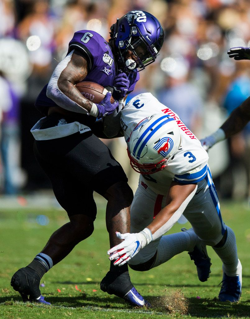 TCU Horned Frogs running back Darius Anderson (6) avoids a tackle by Southern Methodist Mustangs linebacker Delano Robinson (3) before running to the end zone for a touchdown during the second quarter of a college football game between SMU and TCU on Saturday, September 21, 2019 at Amon G. Carter Stadium in Fort Worth.