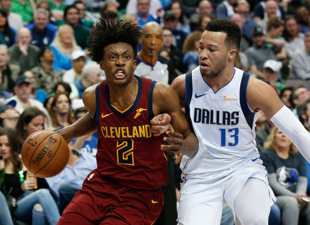Cleveland Cavaliers guard Collin Sexton (2) tries to get past Dallas Mavericks guard Jalen Brunson (13) during the second half of an NBA basketball game in Dallas, Saturday, March 16, 2019. (AP Photo/Michael Ainsworth)