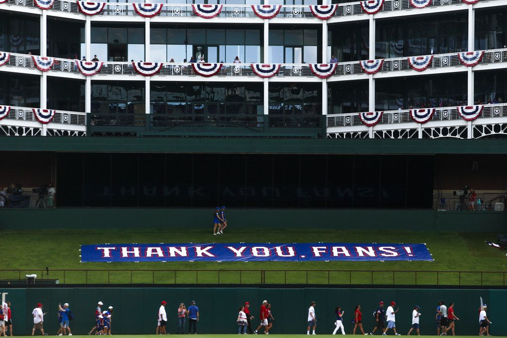 Fans enter the stadium before a MLB game between Texas Rangers and New York Yankees on Sunday, September 29, 2019 at Globe Life Park in Arlington, Texas.