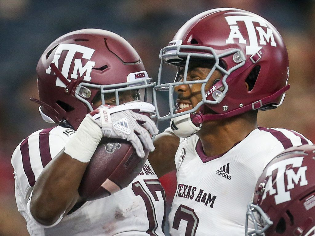 Texas A&M Aggies wide receiver Ainias Smith (17) celebrates his touchdown with wide receiver Jhamon Ausbon (2) during the first half of a NCAA football game between Texas A&M Aggies and Arkansas Razorbacks on Saturday, September 28, 2019 at AT&T Stadium in Arlington, Texas. (Shaban Athuman/Staff Photographer)