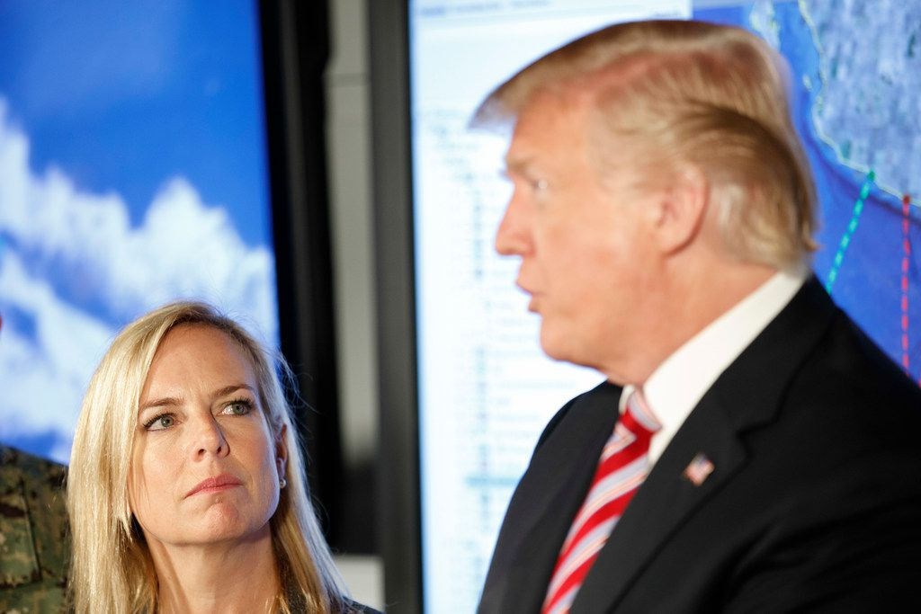 Kirstjen Nielsen, Homeland Security secretary, listens as President Donald Trump speaks at the Joint Interagency Task Force South, a federal narcotics interdiction operation in Key West, Fla.