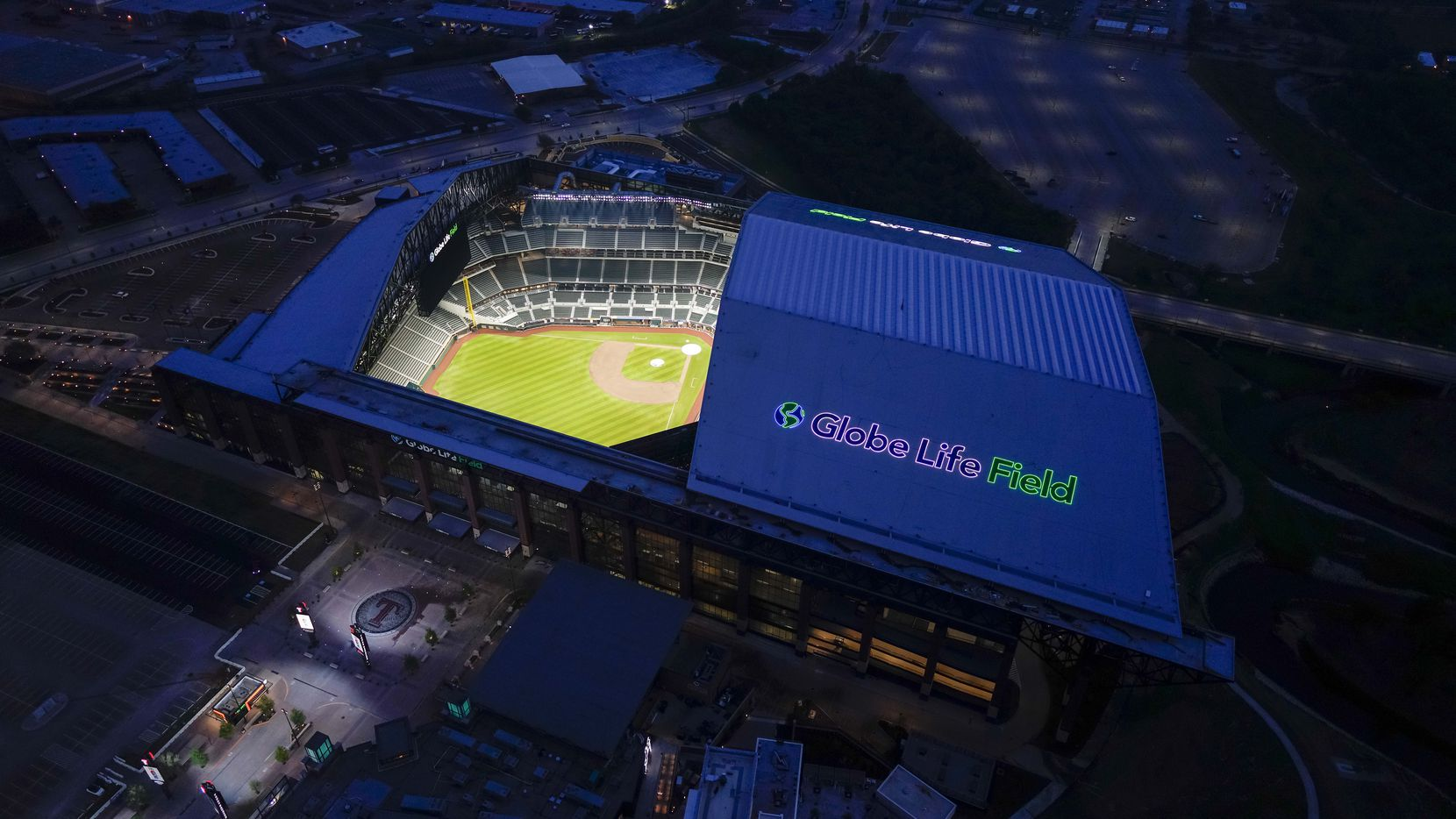 An aerial view of Globe Life Field in Arlington, Texas emphasizes the retractable roof, a key difference compared to the former home of the Texas Rangers.