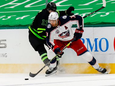 Dallas Stars right wing Nick Caamano (17) attempts to take the puck from Columbus Blue Jackets defenseman Seth Jones (3) in the third period at American Airlines Center in Dallas on Saturday, April 17, 2021. Stars won, 5-1.
